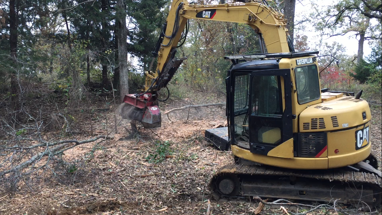 cat 308c with Fecon mulching attachment